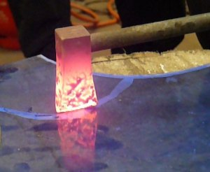 Using a red hot iron to cut glass. Image courtesy of Katie Harrison